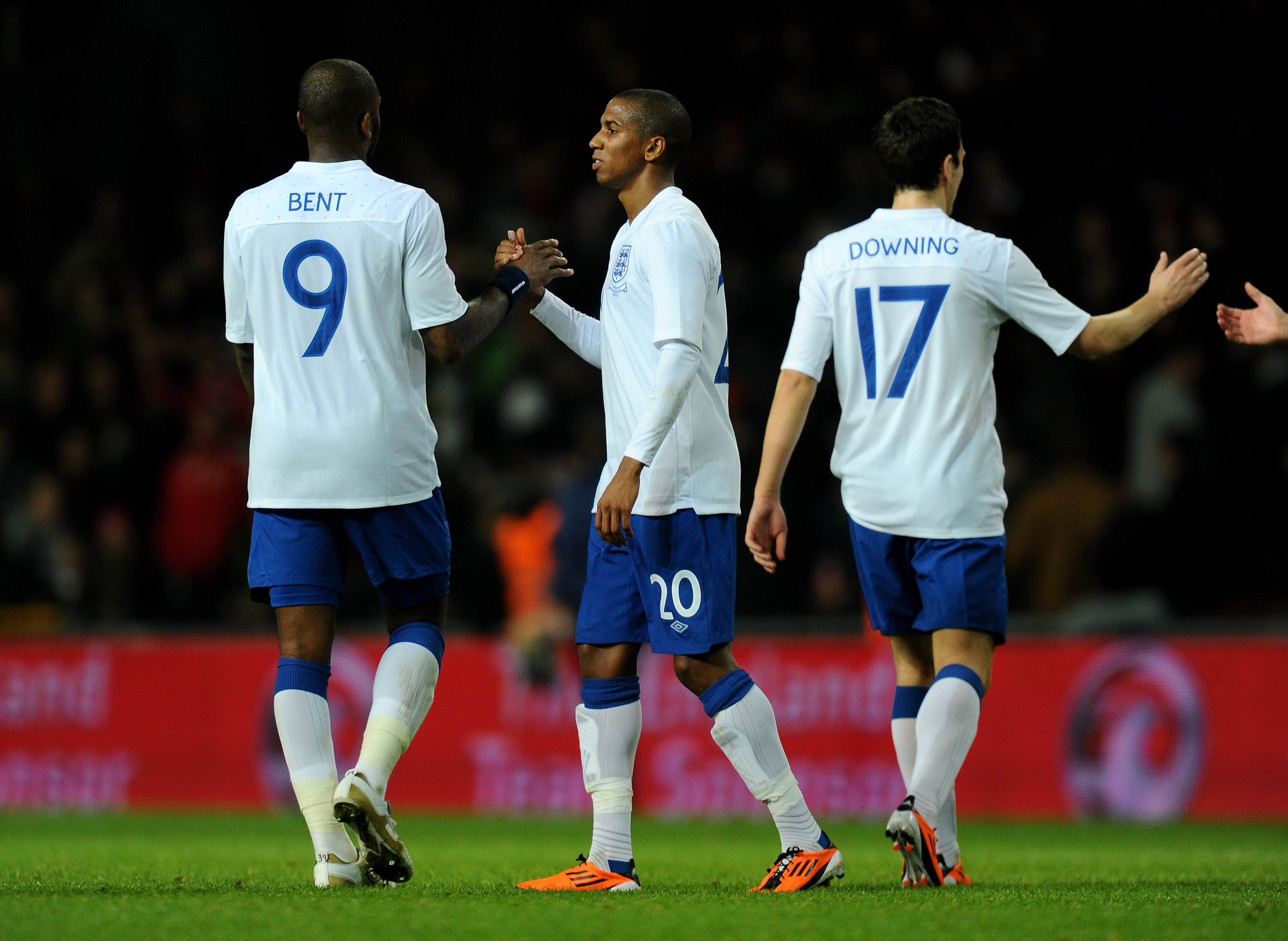 COPENHAGEN, DENMARK - FEBRUARY 09:  Ashley Young of England is congratulated by team mate Darren Bent after scoring his team's second goal during the International Friendly match between Denmark and England at Parken Stadium on February 9, 2011 in Copenha