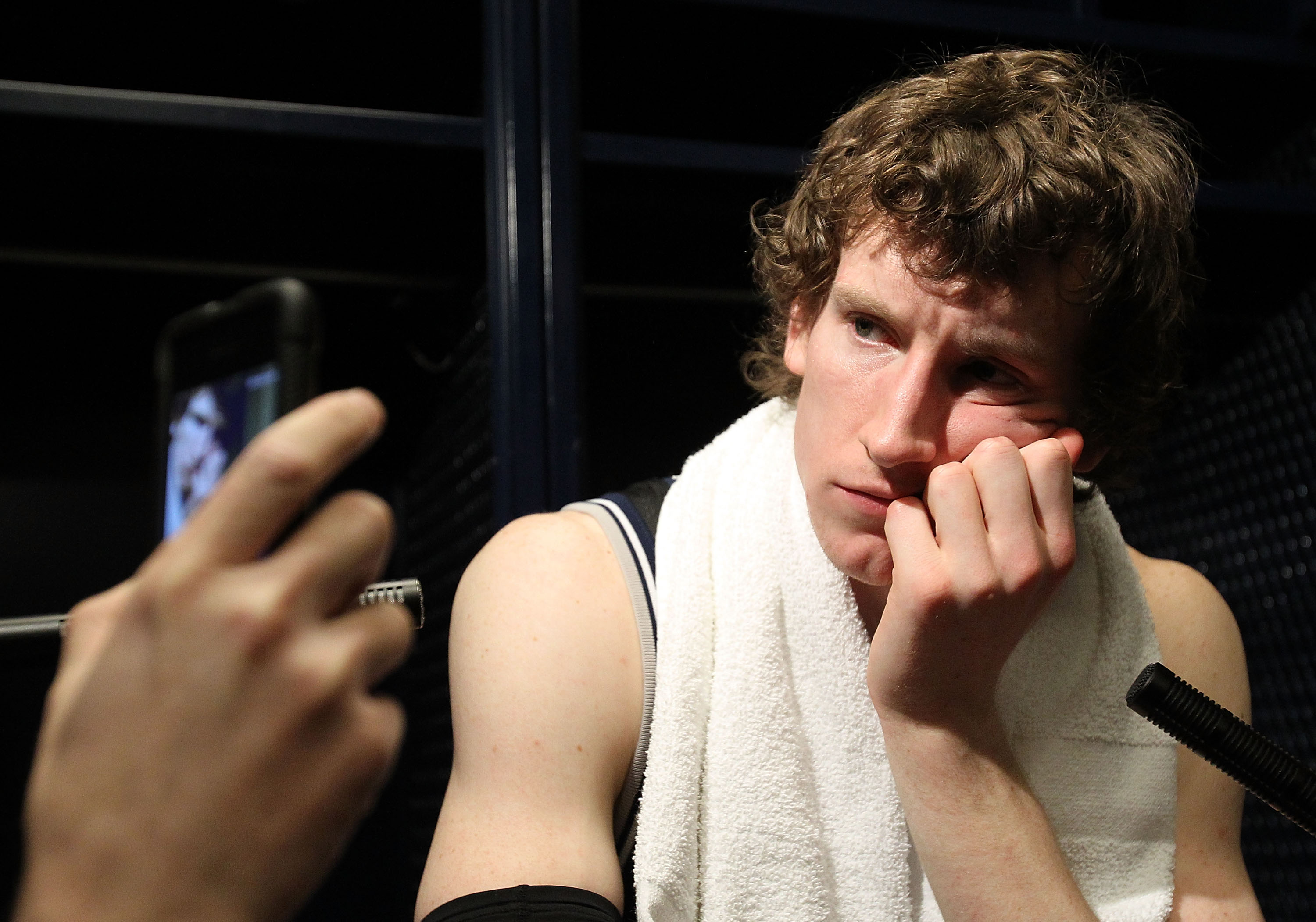 HOUSTON, TX - APRIL 04:  Matt Howard #54 of the Butler Bulldogs talks to the media after losing to the Connecticut Huskies in the National Championship Game of the 2011 NCAA Division I Men's Basketball Tournament at Reliant Stadium on April 4, 2011 in Hou