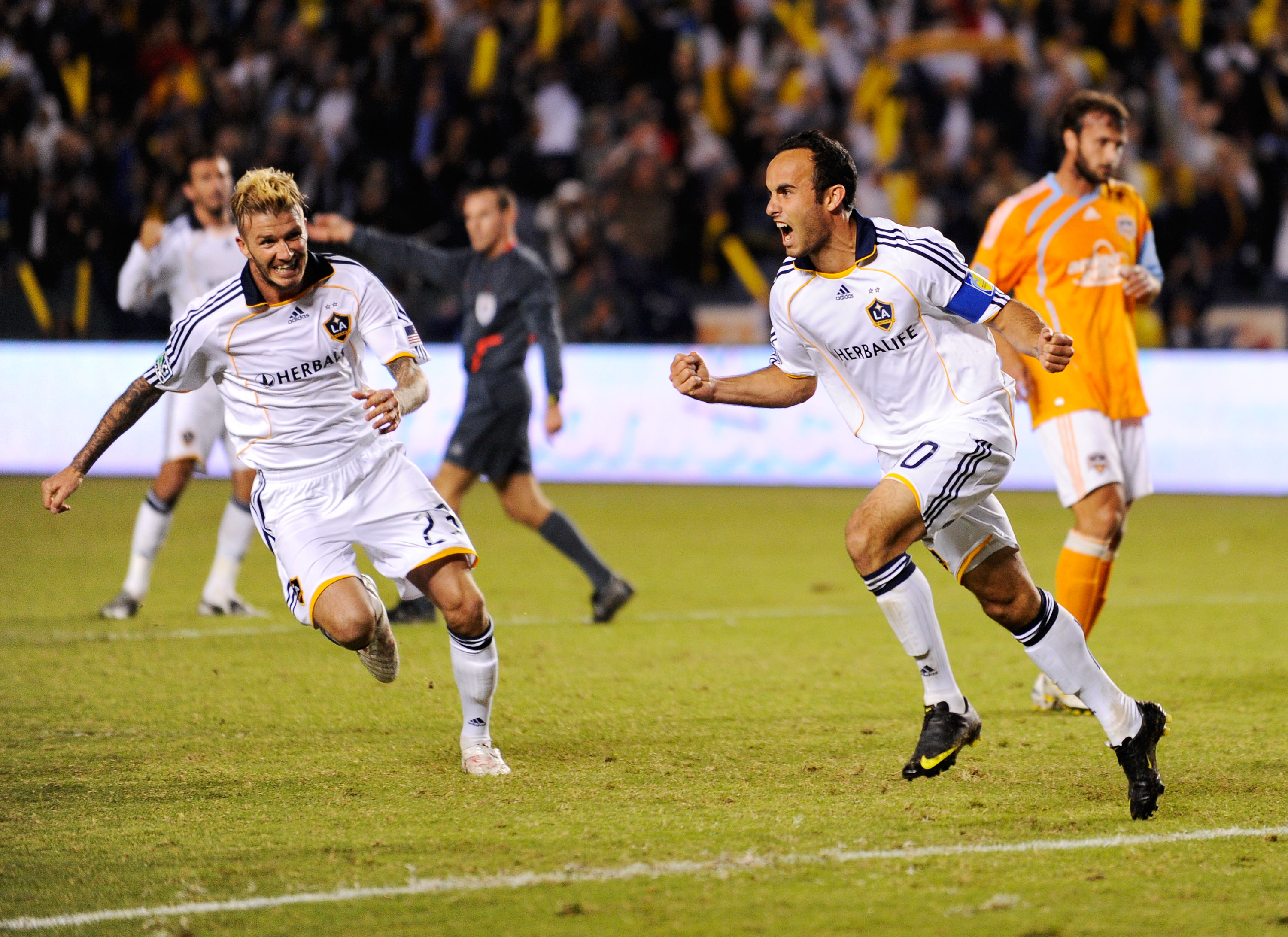 CARSON, CA - NOVEMBER 13:  David Beckham #23  and Landon Donovan #10 of the Los Angeles Galaxy celebrate after Donovan's goal on a penalty kick against  Houston Dynamo during the MLS Western Conference Championship soccer match at The Home Depot Center on