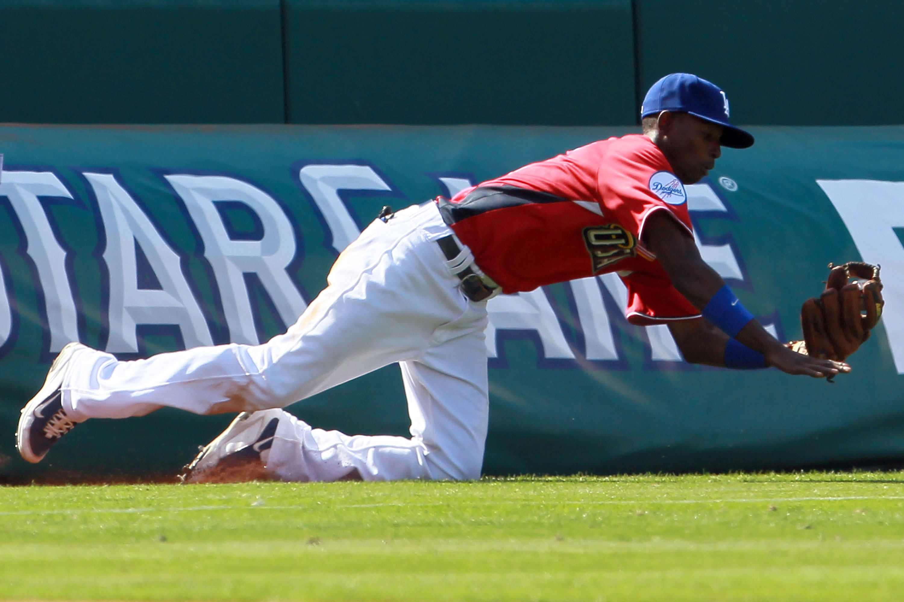 ANAHEIM, CA - JULY 11:  U.S. Futures All-Star Dee Gordon #5 of the Los Angeles Dodgers dives for the ball during the 2010 XM All-Star Futures Game at Angel Stadium of Anaheim on July 11, 2010 in Anaheim, California.  (Photo by Jeff Gross/Getty Images)