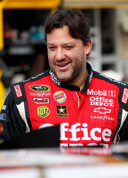 BRISTOL, TN - MARCH 19: Tony Stewart, driver of the #14 Office Depot/Mobil 1 Chevrolet, stands on pit road prior to practice for the NASCAR Sprint Cup Series Jeff Byrd 500 Presented By Food City at Bristol Motor Speedway on March 19, 2011 in Bristol, Tenn