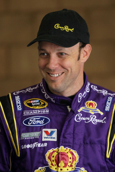 FONTANA, CA - MARCH 25:  Matt Kenseth, driver of the #17 Crown Royal Ford, stands in the garage area during practice for the NASCAR Sprint Cup Series Auto Club 400 at Auto Club Speedway on March 25, 2011 in Fontana, California.  (Photo by Jeff Gross/Getty