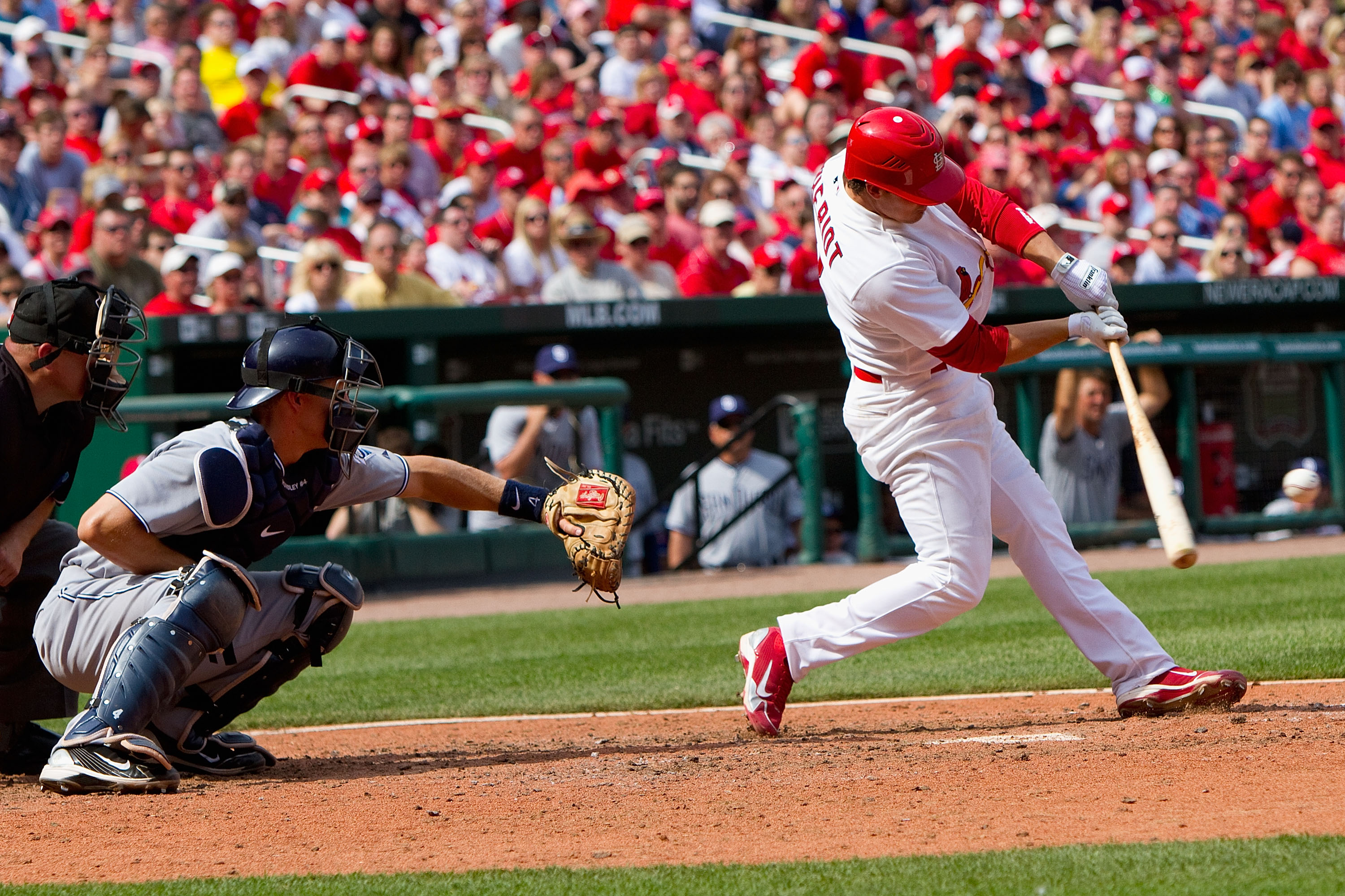 ST. LOUIS, MO - APRIL 3: Ryan Theriot #3 of the St. Louis Cardinals hits an RBI single against the San Diego Padre at Busch Stadium on April 3, 2011 in St. Louis, Missouri.  (Photo by Dilip Vishwanat/Getty Images)