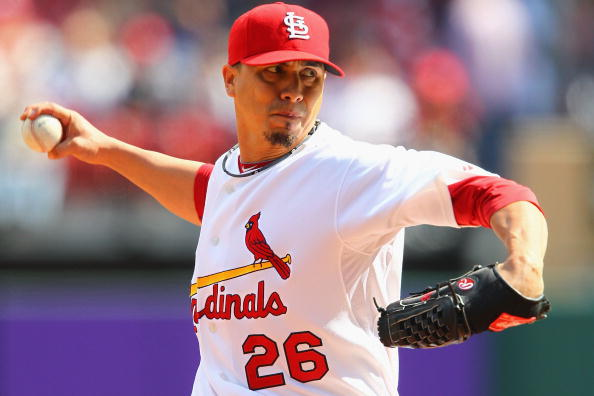 ST. LOUIS - OCTOBER 2: Starter Kyle Lohse #26 of the St. Louis Cardinals against the Colorado Rockies at Busch Stadium on October 2, 2010 in St. Louis, Missouri.  The Cardinals beat the Rockies 1-0 in 11 innings.  (Photo by Dilip Vishwanat/Getty Images)