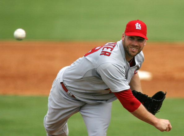 JUPITER, FL - MARCH 01:  Pitcher Chris Carpenter #29 of the St. Louis Cardinals throws against the Florida Marlins at Roger Dean Stadium on March 1, 2011 in Jupiter, Florida.  (Photo by Marc Serota/Getty Images)