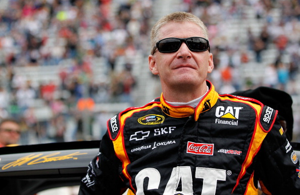 BRISTOL, TN - MARCH 20: Jeff Burton, driver of the #31 Caterpillar Chevrolet, stands on the grid prior to the start of the NASCAR Sprint Cup Series Jeff Byrd 500 Presented By Food City at Bristol Motor Speedway on March 20, 2011 in Bristol, Tennessee.  (P