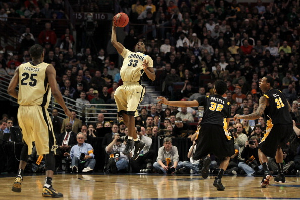 CHICAGO, IL - MARCH 20:  E'Twaun Moore #33 of the Purdue Boilermakers catches the ball as Brandon Rozzell #32 and Toby Veal #31 of the Virginia Commonwealth Rams look on in the first half during the third round of the 2011 NCAA men's basketball tournament