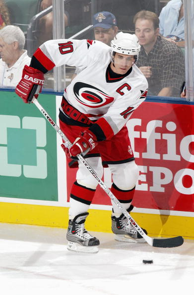 SUNRISE, FL - OCTOBER 9:  Center Ron Francis #10 of the Carolina Hurricanes plays the puck near the boards during the game against the Florida Panthers on October 9, 2003 at the Office Depot Center in Sunrise, Florida.  The Panthers defeated the Hurricane