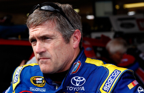 AVONDALE, AZ - FEBRUARY 25:  Bobby Labonte, driver of the #47 Clorox Toyota, stands in the garage area during practice for the Subway Fresh Fit 500 at Phoenix International Raceway on February 25, 2011 in Avondale, Arizona.  (Photo by Tom Pennington/Getty