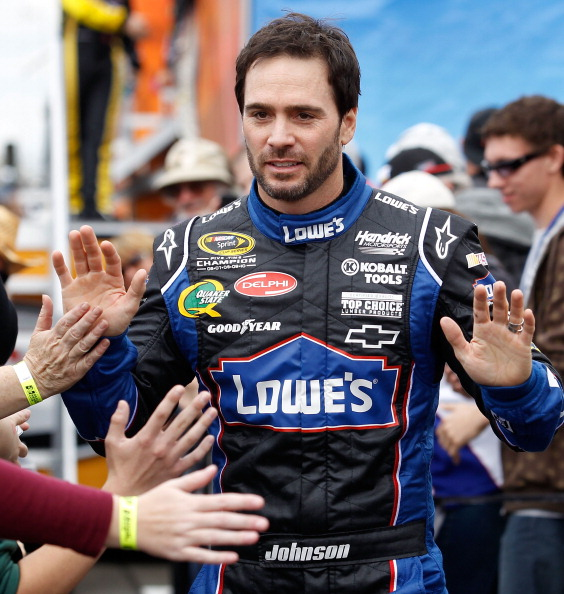 FONTANA, CA - MARCH 27:  Jimmie Johnson, driver of the #48 Lowe's Chevrolet, greets fans during driver introductions for the NASCAR Sprint Cup Series Auto Club 400 at Auto Club Speedway on March 27, 2011 in Fontana, California.  (Photo by Todd Warshaw/Get
