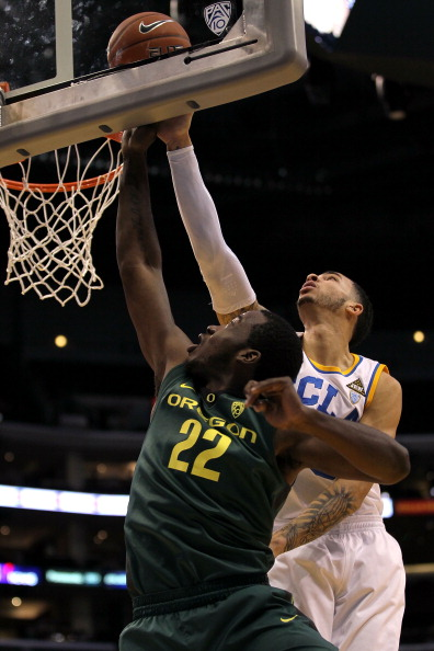 LOS ANGELES, CA - MARCH 10:  Teondre Williams #22 of the Oregon Ducks lays the ball up in front of Tyler Honeycutt #23 of the UCLA Bruins in the first half in the quarterfinals of the 2011 Pacific Life Pac-10 Men's Basketball Tournament at Staples Center