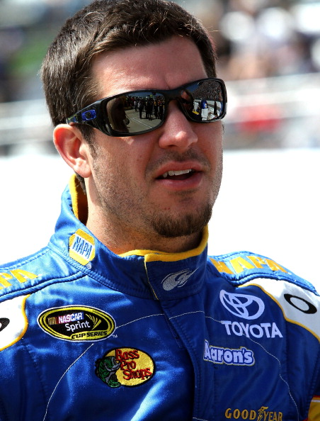 MARTINSVILLE, VA - APRIL 03:  Martin Truex Jr., driver of the #56 NAPA Auto Parts Toyota, stands on the grid prior to the NASCAR Sprint Cup Series Goody's Fast Relief 500 at Martinsville Speedway on April 3, 2011 in Martinsville, Virginia.  (Photo by Jerr