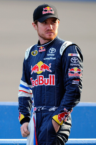 FONTANA, CA - MARCH 25:  Brian Vickers, driver of the #83 Red Bull Toyota, stands on pit road during qualifying for the NASCAR Sprint Cup Series Auto Club 400 at Auto Club Speedway on March 25, 2011 in Fontana, California.  (Photo by Jared C. Tilton/Getty