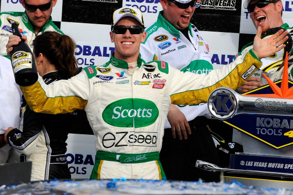 LAS VEGAS, NV - MARCH 06:  Carl Edwards, driver of the #99 Scotts/Kellogg's Ford, celebrates in Victory Lane after winning the NASCAR Sprint Cup Series Kobalt Tools 400 at Las Vegas Motor Speedway on March 6, 2011 in Las Vegas, Nevada.  (Photo by Jared C.