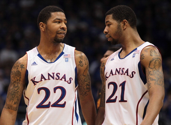 LAWRENCE, KS - DECEMBER 18:  Marcus Morris #22 and Markieff Morris #21 of the Kansas Jayhawks talk during the game against the USC Trojans on December 18, 2010 at Allen Fieldhouse in Lawrence, Kansas.  (Photo by Jamie Squire/Getty Images)