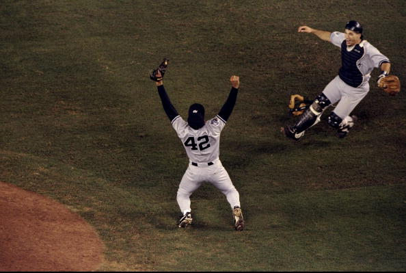 21 Oct 1998: Pitcher Mariano Rivera #42 and catcher Joe Girardi #25 of the New York Yankees celebrate following the 1998 World Series Game 4 against the San Diego Padres at Qualcomm Stadium in San Diego, California. The Yankees defeated the Padres 3-0.