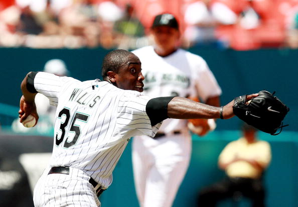 MIAMI - AUGUST 19:  Dontrelle Willis #35 of the Florida Marlins throws to first after knocking down a line drive by Rich Aurilia of the San Francisco Giants in the sixth inning at Dolphin Stadium on August 19, 2007 in Miami, Florida.  (Photo by Doug Benc/