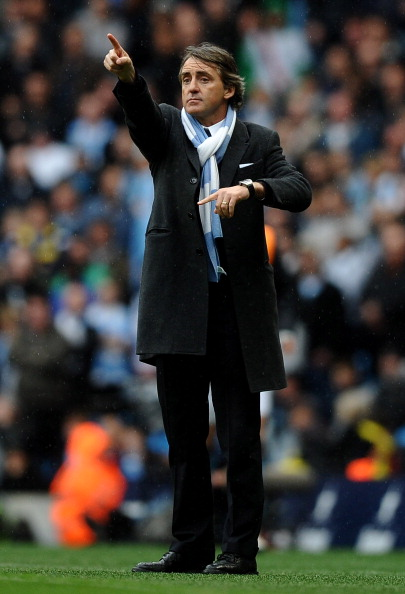 MANCHESTER, ENGLAND - APRIL 03:  Manchester City Manager Roberto Mancini gestures to his players during the Barclays Premier League match between Manchester City and Sunderland at the City of Manchester Stadium on April 3, 2011 in Manchester, England.  (P
