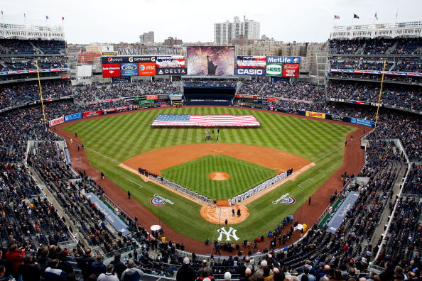 NEW YORK, NY - MARCH 31:  The National Anthem is performed by Haley Swindal as the US Navy Super Hornet flyover takes place before the New York Yankees face the Detroit Tigers on Opening Day at Yankee Stadium on March 31, 2011 in the Bronx borough of New