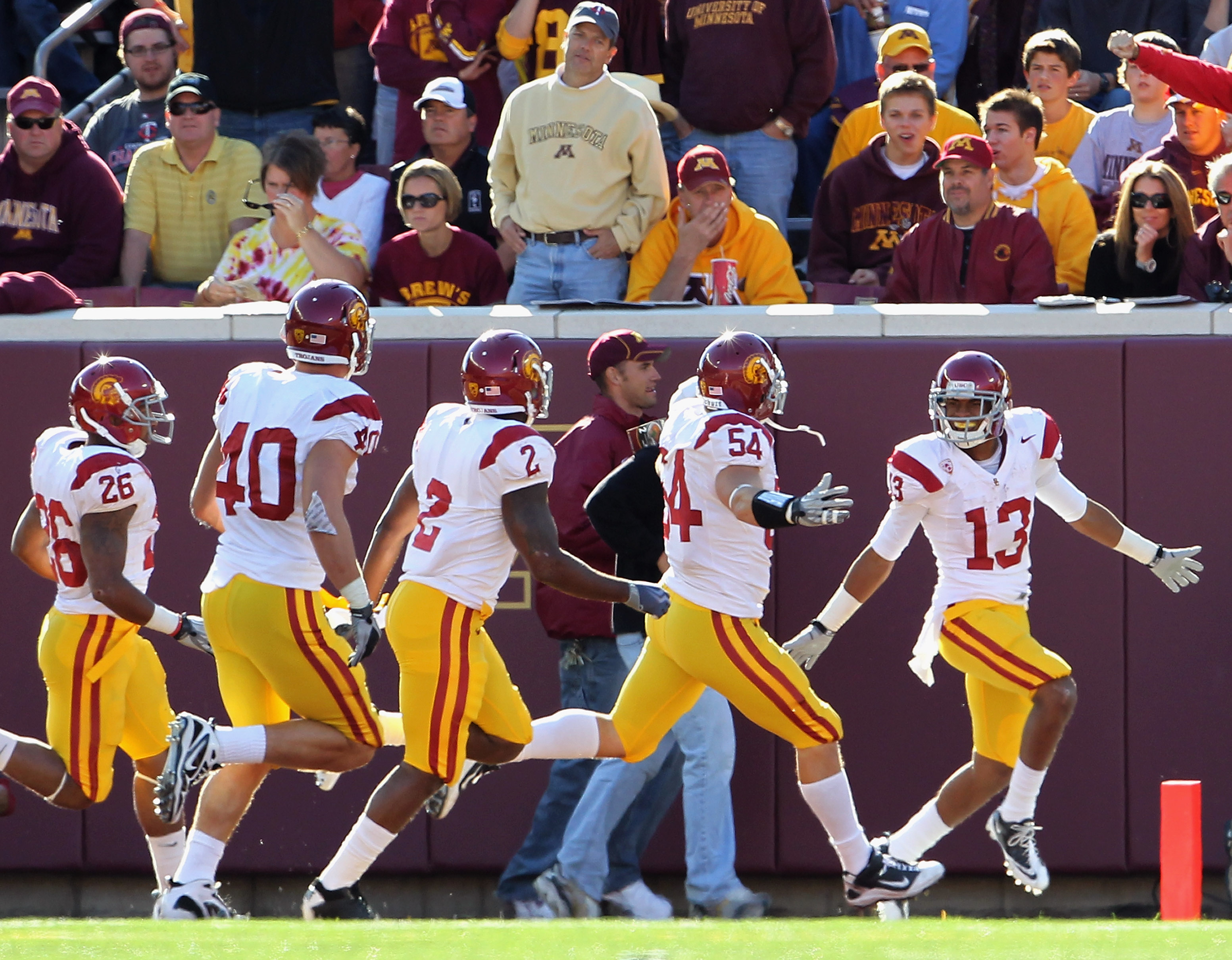 MINNEAPOLIS - SEPTEMBER 18:  Robert Woods #13 of the USC Trojans celebrates with teammates after scoring a touchdown during the game against the Minnesota Golden Gophers on September 18, 2010 at TCF Bank Stadium in Minneapolis, Minnesota.  (Photo by Jamie