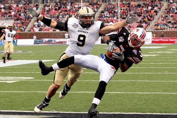 DALLAS, TX - DECEMBER 30:  Wide receiver Darius Johnson #3 of the SMU Mustangs makes a touchdown pass against Steven Erzinger #9 of the Army Black Knights during the Bell Helicopter Armed Forces Bowl at Gerald J. Ford Stadium on December 30, 2010 in Dalla