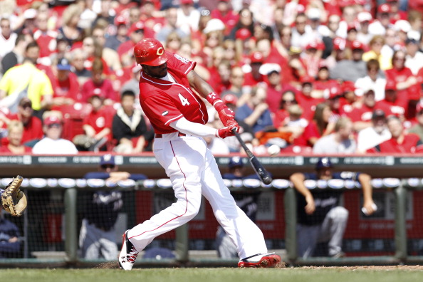 CINCINNATI, OH - APRIL 3: Brandon Phillips #4 of the Cincinnati Reds hits a three-run home run in the 4th inning against the Milwaukee Brewers at Great American Ball Park on April 3, 2011 in Cincinnati, Ohio. The Reds won 12-3. (Photo by Joe Robbins/Getty