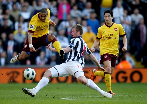 WEST BROMWICH, ENGLAND - MARCH 19:  Chris Brunt of WBA (C) in action with Samir Nasri (R)and Gael CLichy (L) of Arsenal during the Barclays Premier League match between West Bromwich Albion and Arsenal at The Hawthorns on March 19, 2011 in West Bromwich,