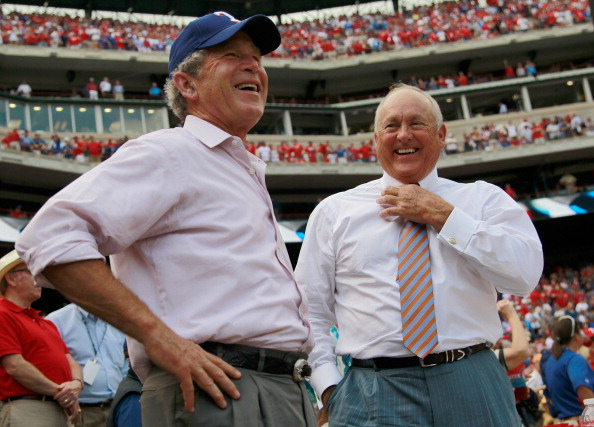 ARLINGTON, TX - APRIL 01:  Former U.S. President George W. Bush shares a laugh with Texas Rangers President and CEO Nolan Ryan on Opening Day at Rangers Ballpark in Arlington on April 1, 2011 in Arlington, Texas.  (Photo by Tom Pennington/Getty Images)