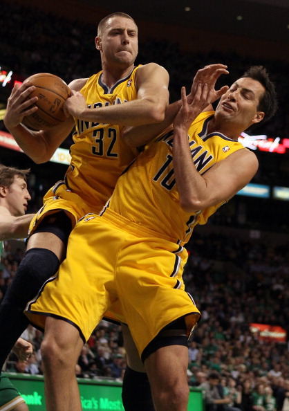 BOSTON, MA - MARCH 16:  Josh McRoberts #32 and Jeff Foster #10 of the Indiana Pacers fight for the rebound in the first half against the Boston Celtics on March 16, 2011 at the TD Garden in Boston, Massachusetts.  NOTE TO USER: User expressly acknowledges
