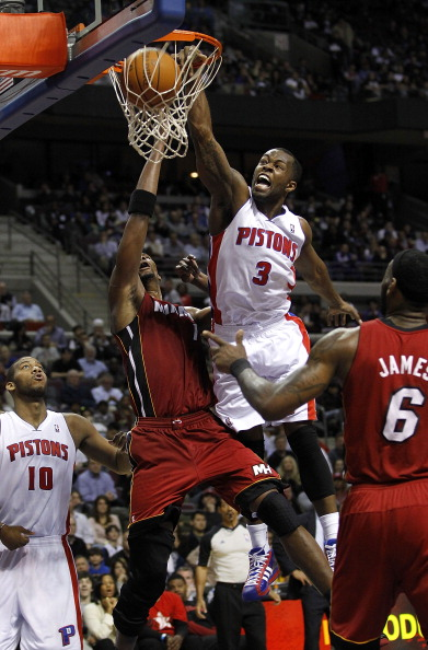 AUBURN HILLS, MI - MARCH 23: Rodney Stuckey #3 Detroit Pistons gets in for a dunk between Chris Bosh #1 and LeBron James #6 of the  Miami Heat at The Palace of Auburn Hills on March 23, 2011 in Auburn Hills, Michigan. Miami won the game 100-94. NOTE TO US