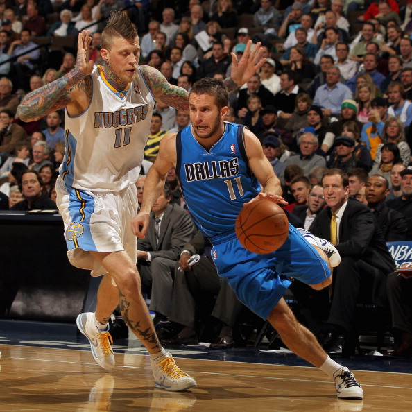 DENVER, CO - FEBRUARY 10:  Jose Barea #11 of the Dallas Mavericks drives the ball against Chris Andersen #11 of the Denver Nuggets during NBA action at the Pepsi Center on February 10, 2011 in Denver, Colorado. NOTE TO USER: User expressly acknowledges an