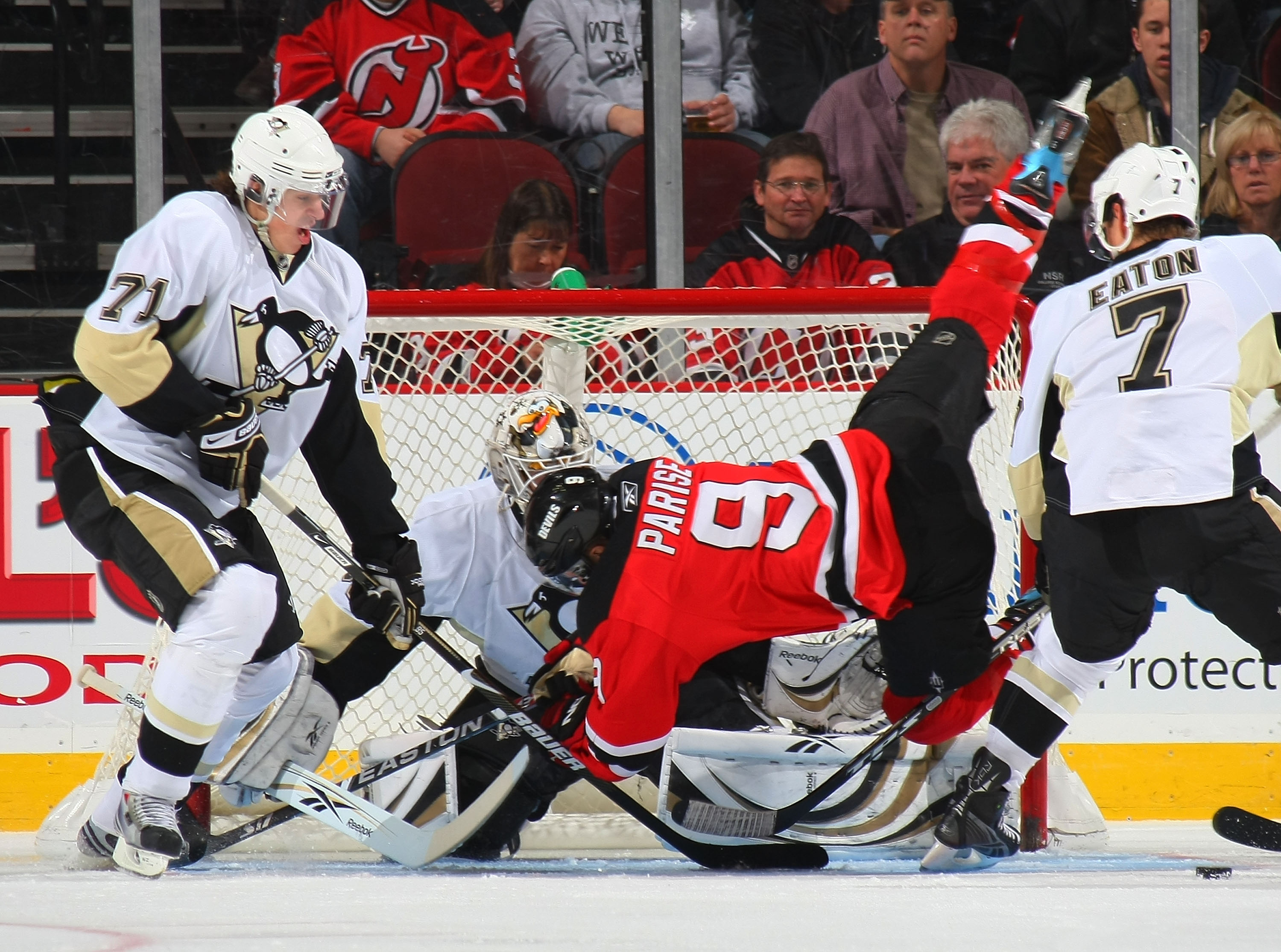 NEWARK, NJ - DECEMBER 10: Goaltender Dany Sabourin #30 of the Pittsburgh Penguins blocks a shot by Zach Parise #9 of the New Jersey Devils as Evgeni Malkin #71 looks for the rebound on December 10, 2008 at the Prudential Center in Newark, New Jersey. (Pho