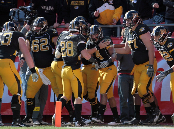 KANSAS CITY, MO - NOVEMBER 27:  Kendial Lawrence #4 of the Missouri Tigers is congratulated after scoring a touchdown during the game against the Kansas Jayhawks on November 27, 2010 at Arrowhead Stadium in Kansas City, Missouri.  (Photo by Jamie Squire/G