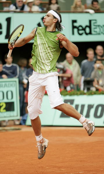 PARIS - JUNE 05:  Rafael Nadal of Spain celebrates a point during the Mens Final match against Mariano Puerta of Argentina on the fourteenth day of the French Open at Roland Garros on June 5, 2005 in Paris, France.  (Photo by Clive Mason/Getty Images)