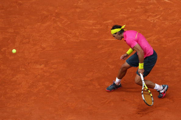 PARIS - MAY 31:  A dejected Rafael Nadal of Spain misses a shot as he heads towards defeat during the Men's Singles Fourth Round match against Robin Soderling of Sweden on day eight of the French Open at Roland Garros on May 31, 2009 in Paris, France.  (P