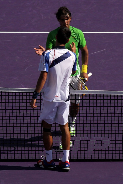 KEY BISCAYNE, FL - APRIL 03:  Novak Djokovic (bottom) of Serbia is congratulated by Rafael Nadal of Spain after Djokovic won their match during the men's singles championship at the Sony Ericsson Open at Crandon Park Tennis Center on April 3, 2011 in Key