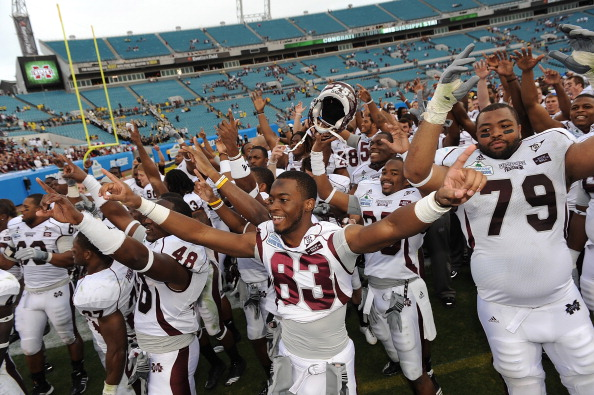 JACKSONVILLE, FL - JANUARY 01:  The Mississippi Bulldogs players celebrate following their victory over the Michigan Wolverines at the Gator Bowl at EverBank Field on January 1, 2011 in Jacksonville, Florida  (Photo by Rick Dole/Getty Images)