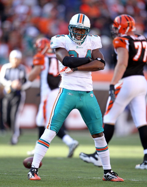 CINCINNATI - OCTOBER 31:  Sean Smith #24 of the Miami Dolphins celebrates after intercepting a pass during the NFL game against the Cincinnati Bengals at Paul Brown Stadium on October 31, 2010 in Cincinnati, Ohio.  (Photo by Andy Lyons/Getty Images)