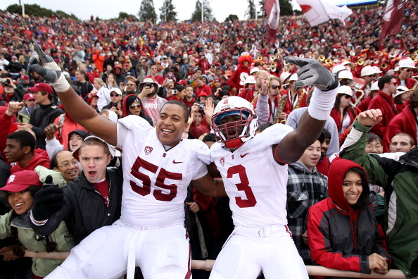 BERKELEY, CA - NOVEMBER 20:  Michael Thomas #3 and Jonathan Martin #55 of the Stanford Cardinal celebrate after beating the California Golden Bears at California Memorial Stadium on November 20, 2010 in Berkeley, California.  (Photo by Ezra Shaw/Getty Ima