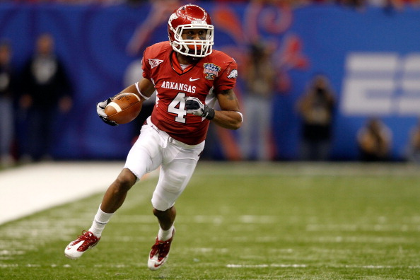 NEW ORLEANS, LA - JANUARY 04:  Jarius Wright #4 of the Arkansas Razorbacks runs after a catch against the Ohio State Buckeyes during the Allstate Sugar Bowl at the Louisiana Superdome on January 4, 2011 in New Orleans, Louisiana.  (Photo by Matthew Stockm