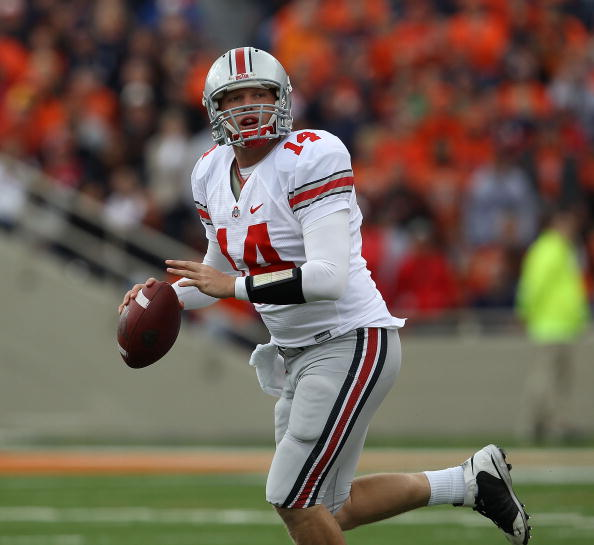 CHAMPAIGN, IL - OCTOBER 02: Joe Bauserman #14 of the Ohio State Buckeyes rolls out to look for a receiver against the Illinois Fighting Illini at Memorial Stadium on October 2, 2010 in Champaign, Illinois. Ohio State defeated Illinois 24-13. (Photo by Jon