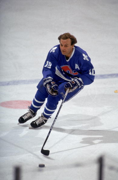 BUFFALO, NY - 1990:  Right wing Guy Lafleur #01 of the Quebec Nordiques skates with the puck during warmups prior to a 1990 NHL game against the Buffalo Sabres at the Memorial Auditorium in Buffalo, New York.  (Photo by Rick Stewart/Getty Images)