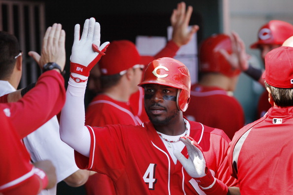 CINCINNATI, OH - APRIL 3: Brandon Phillips #4 of the Cincinnati Reds celebrates with teammates after hitting a three-run home run in the 4th inning against the Milwaukee Brewers at Great American Ball Park on April 3, 2011 in Cincinnati, Ohio. The Reds wo