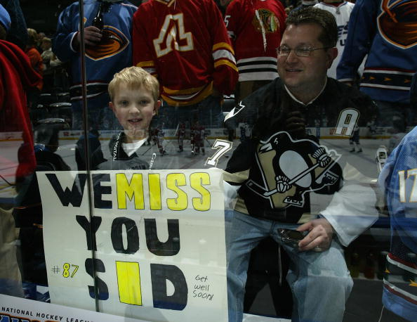 ATLANTA - JANUARY 27:  A fan of Sidney Crosby #87 of the Pittsburgh Penguins holds up sign during warm ups to the 56th NHL All-Star Game due to injury at Philips Arena on January 27, 2008 in Atlanta, Georgia.  (Photo by Dave Sandford/Getty Images)