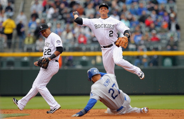 DENVER, CO - APRIL 06:  Shortstop Troy Tulowitzki #2 of the Colorado Rockies turns a double play over Matt Kemp #27 of the Los Angeles Dodgers after he fielded a ground ball by James Loney #7 of the Los Angeles Dodgers as second baseman Jose Lopez #22 of