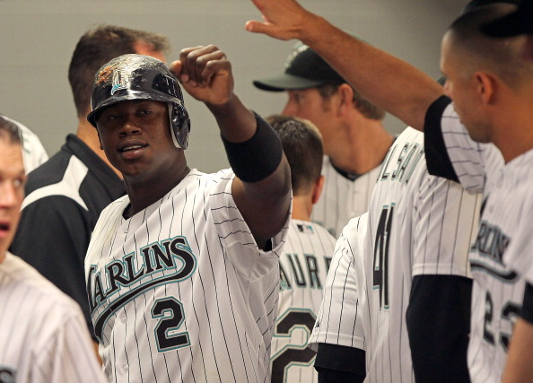 MIAMI GARDENS, FL - APRIL 01: Hanley Ramirez #2 of the Florida Marlins is congratulated after scoring a run during opening day against the New York Mets at Sun Life Stadium on April 1, 2011 in Miami Gardens, Florida.  (Photo by Mike Ehrmann/Getty Images)