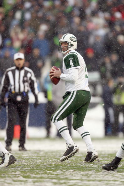 SEATTLE - DECEMBER 21:  Quarterback Brett Favre #4 of the New York Jets drops back to pass during the game against the Seattle Seahawks on December 21, 2008 at Qwest Field in Seattle, Washington. The Seahawks defeated the Jets 13-3. (Photo by Otto Greule