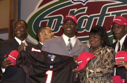 21 Apr 2001:  Michael Vick poses with with his family after Vick was selected first in the NFL Draft by the Atlanta Falcons at Madison Square Garden in New York City. Mandatory Credit: Ezra Shaw/ALLSPORT
