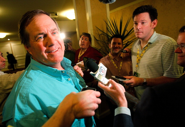 NEW ORLEANS, LA - MARCH 22:  New England head coach Bill Belichick jokes with reporters after missing morning breakfast durning the NFL Annual Meeting at the Roosevelt Hotel on March 22, 2011 in New Orleans, Louisiana.  (Photo by Sean Gardner/Getty Images