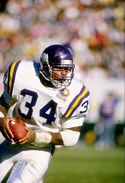 26 Nov 1989:  Running back Herschel Walker of the Minessota Vikings runs with the ball during a game against the Green Bay Packers at Lambeau Field in Green Bay, Wisconsin.  The Packers won the game 20-19. Mandatory Credit: Jonathan Daniel  /Allsport